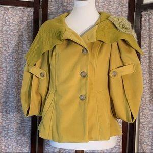 Ryu: mustard yellow open sleeve coat.